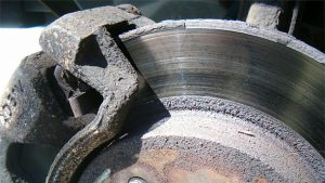 Worn brakes - rusted caliper and rotor